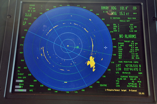 The RADAR system measures the distance and bearing to nearby RADAR-visible targets and plots their course, along with the ship's course derived from GPS.