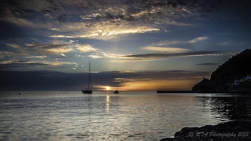 blue orange clouds sunrise pier rocks babbacombe nikond5000