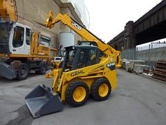 light commercial vehicle(0.0), crane(0.0), forklift truck(0.0), asphalt(1.0), vehicle(1.0), transport(1.0), construction equipment(1.0), bulldozer(1.0),
