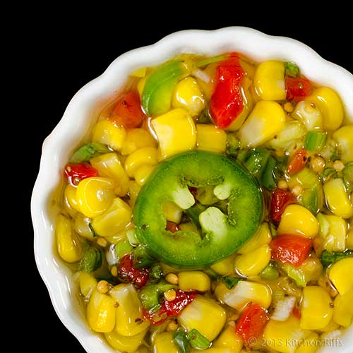 Quick Corn Relish in white ramekin, overhead view on black