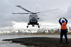 HMS Daring's Lynx Helicopter Bringing Aid to the Philippines