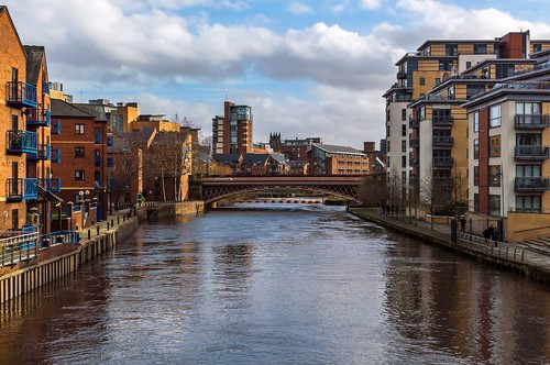 city bridge people reflection water clouds buildings river cityscape yorkshire leeds flats scenary aire towpath