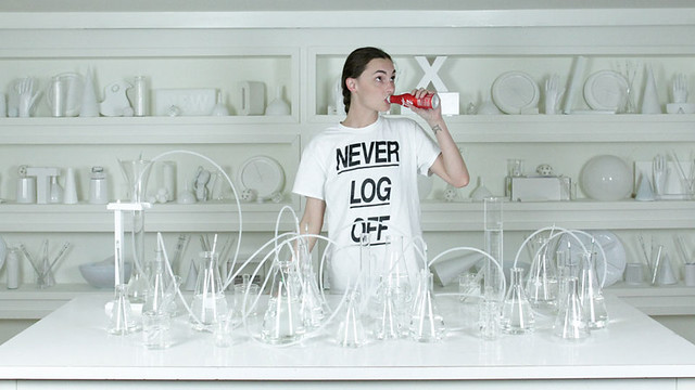 "a photo by krystal south shows a woman wearing a shirt that says ""never log off"""