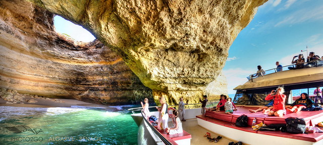 Big Catamaran inside cave in the Algarve