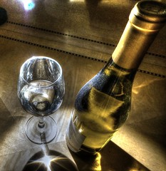 Wine glass and bottle in limelight