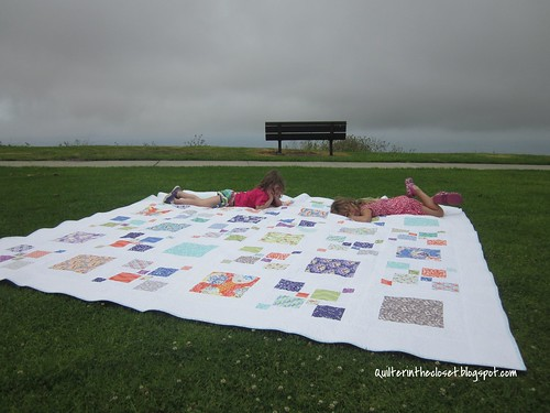 Tired helpers after laying out Gigantor quilt