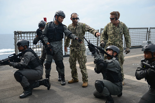 ailors from the Maritime Civil Affairs and Security Training (MCAST) team exchange best practices with a Royal Malaysian Navy