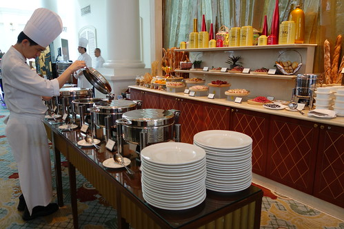 Chef checking on the hot food. Sunday Champagne Brunch at InterContinental Singapore