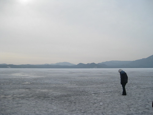 Walking on frozen lake Burabay