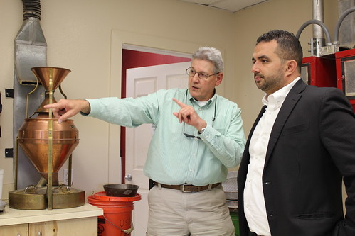Deputy Undersecretary of Agriculture Elvis Cordova (right) touring a grading laboratory during a recent visit to GIPSA facilities in League City, Texas and the port of Houston