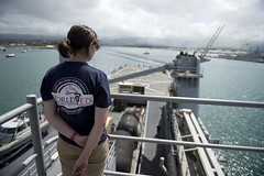 A World Vets volunteer mans the rails aboard USS Pearl Harbor (LSD 52) as the ship departs Joint Base Pearl Harbor-Hickam May 25. (U.S. Navy photo by Mass Communication Specialist 3rd Class Carlos M. Vazquez II)