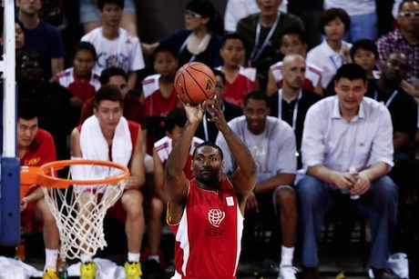 July 1st, 2013 - Metta World Peace puts up a shot with Yao Ming and Tracy McGrady looking on