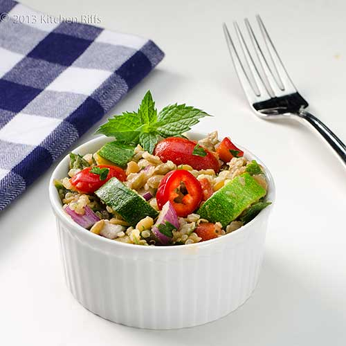Lentil, Quinoa, and Zucchini Salad in ramekin with mint garnish