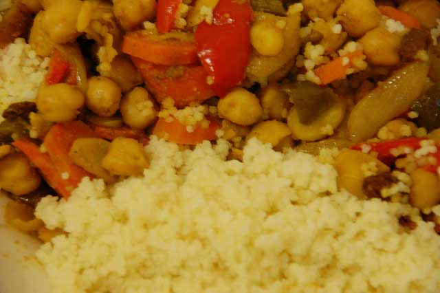 Chickpeas, peppers, carrots and almonds recipe with spices with Couscous