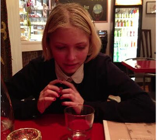 Tavi in a restaurant in chicago, looking pensive