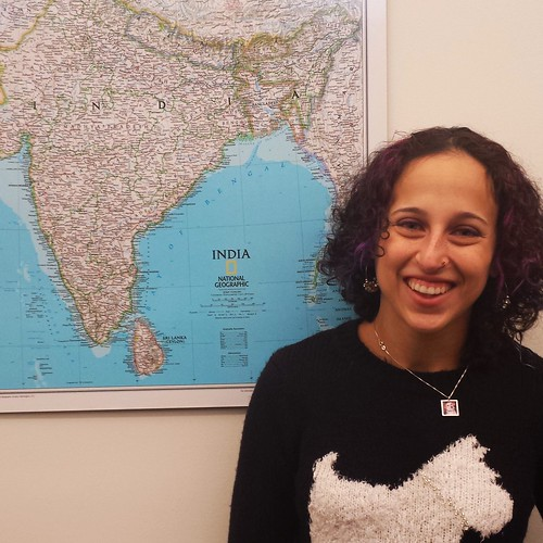 Photograph of Mara next to a map of South Asia