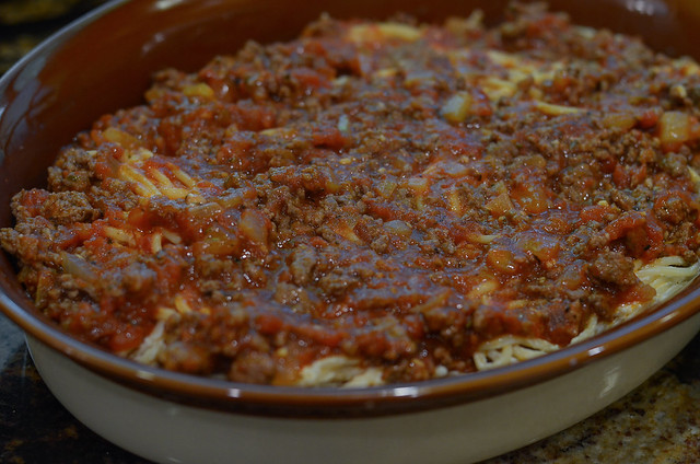Another layer of meat sauce is added to the casserole.
