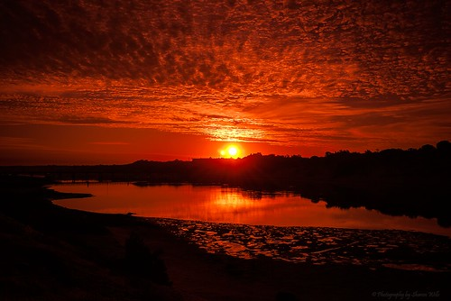 sunset red sky beach water river southport onkaparingariver