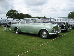 bentley s1(0.0), rolls-royce corniche(0.0), jaguar mark 1(0.0), convertible(0.0), automobile(1.0), rolls-royce(1.0), rolls-royce phantom vi(1.0), rolls-royce phantom v(1.0), bentley s2(1.0), vehicle(1.0), rolls-royce silver shadow(1.0), bentley t-series(1.0), rolls-royce silver cloud(1.0), antique car(1.0), sedan(1.0), classic car(1.0), vintage car(1.0), land vehicle(1.0), luxury vehicle(1.0),