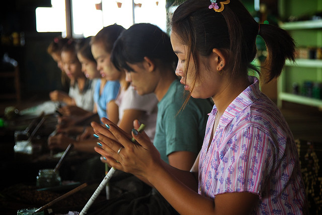 Young girls making sigars at a small sigar factory