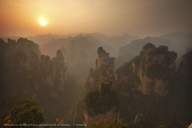 sunrise in misty Zhangjiajie National Forest Park 袁家界日出