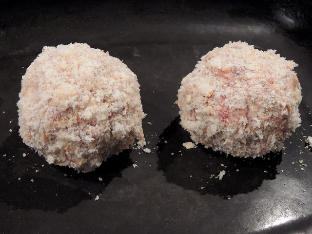 Raw Scotch eggs coated not seasoned
