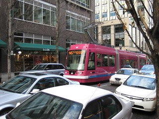 One of the Clackamas streetcars crosses behind Powells Books