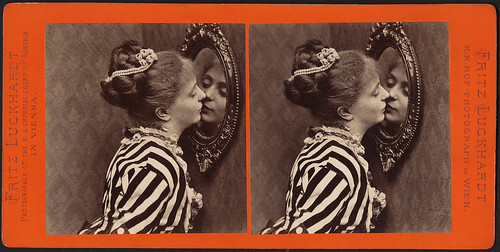 Woman kissing her reflection in the looking glass