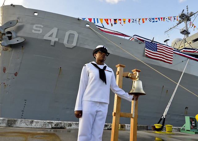 Sailor renders honors at Polaris Point, Guam.