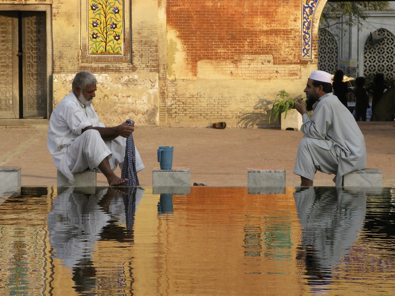 Two Men Purfying Themselves at a Mosque