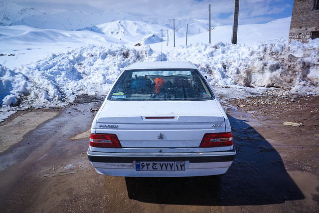 white car in front of snow blocking the road in Sheikh Ali Khan Iran