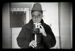 reflected self-portrait with Coronet Viscount camera and plastic cowboy hat