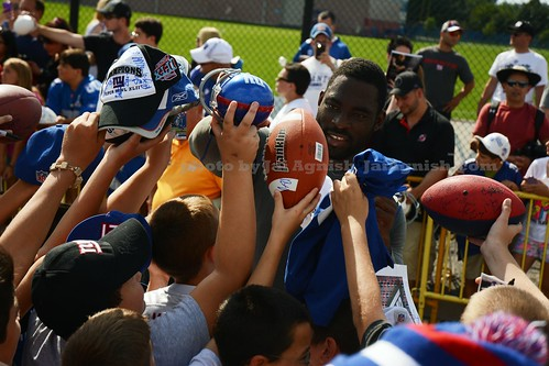 New York Giants Defensive End Justin Tuck signs autographs by Jai Agnish