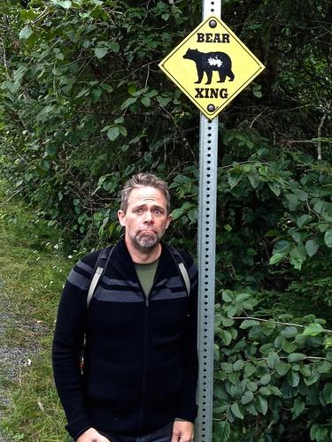 [J.D. under bear sign]