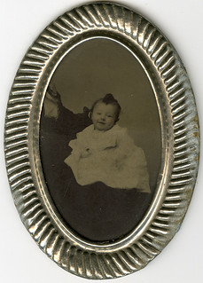 Smiling Baby with a Hidden Mother - Tintype in Oval Metal Frame