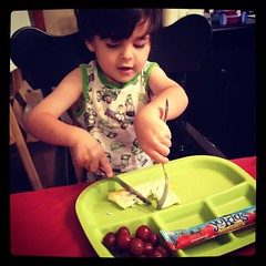 Learning to Cut with a Knife and Fork (Photo from Montessori MOMents)