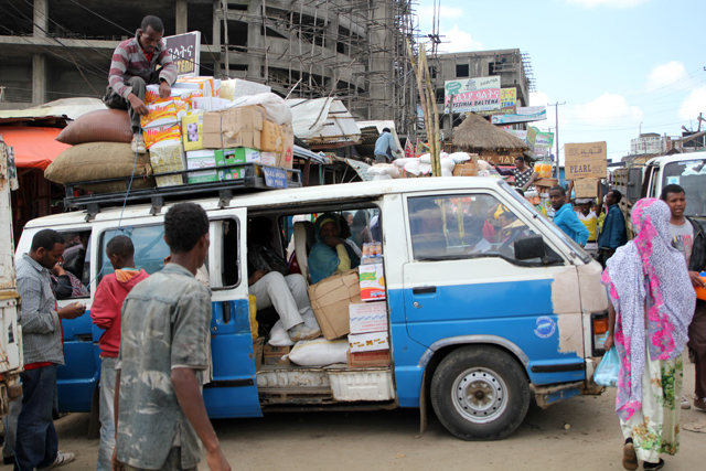 A minibus transporting market goods