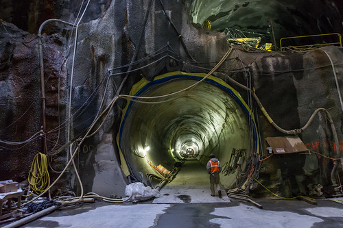 Including a MTA employee helps to show the scale of the subway tunnel.