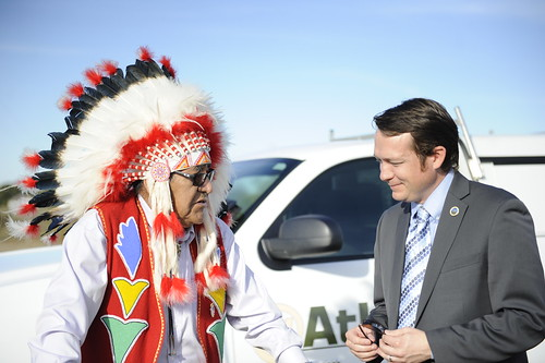 Oklahoma Rural Development State Director Ryan McMullen  visits with Kiowa Tribal elder Jim Anquoe, following Anquoe's blessing of the tower/project. USDA photo.
