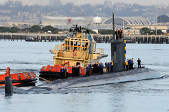 USS Hampton (SSN 767) is guided in by tugs as it returns to Naval Base Point Loma, Dec. 18.  (U.S. Navy photo by Mass Communication Specialist 2nd Class Kyle Carlstrom)