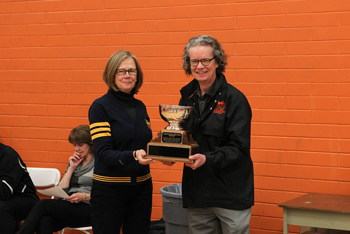 UBCO's Deborah Buszard presents TRU's Alan Shaver Presidents Cup (Men 2013-14 Snucins)
