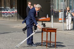 U.S. Secretary of State John Kerry, recovering from a broken leg, lays down his crutches before addressing an international press corps on July 5, 2015, in Vienna, Austria, during a break in P5+1 negotiations with Iranian leaders about the future of their country's nuclear program. [State Department photo/ Public Domain]