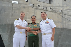Vice Adm. Joseph P. Aucoin, left, commander of U.S. 7th Fleet; Lt. Gen. Dato' Fazil Bin Mukhtar, commander of Malaysia's Joint Forces Command; and Capt. Stansfield Chien, Pacific Partnership mission commander, pause for a photo in front of USNS Fall River (T-EPF 4), April 10. (Royal Malaysian Navy photo)