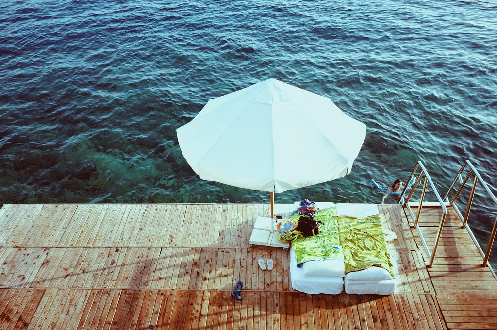 The sunbeds and the umbrella