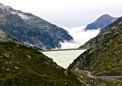 Foggy Grimselsee surrounded by mountains