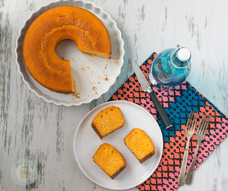 Moroccan-Orange-Cake-Three-Slices on a white plate and the rest of the cake with slices missing also on a white platter