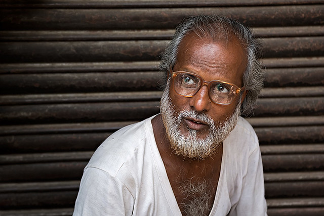 Portrait of a man with glasses in Kolkata, India.