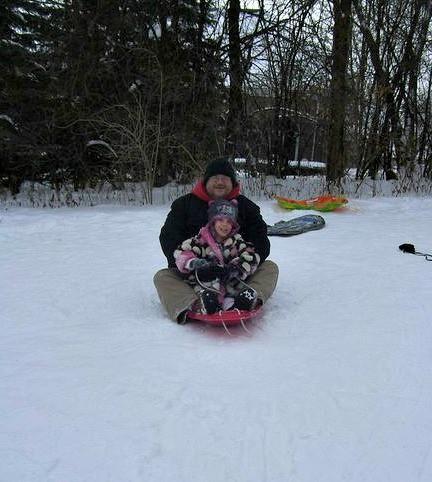 Me and niece Molly sledding