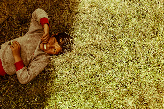 boy-lying-in-grass