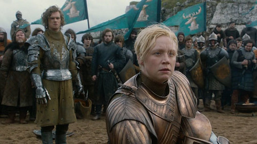The female knight Brienne of Tarth, standing in armor